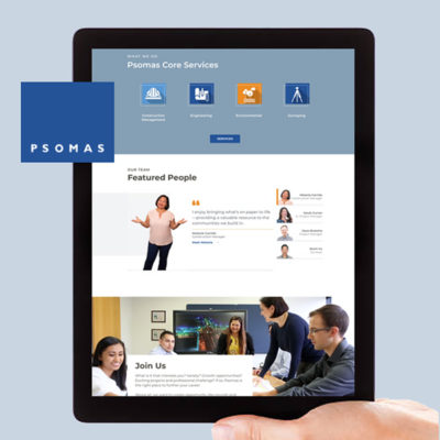 hand holding tablet with Psomas website displayed